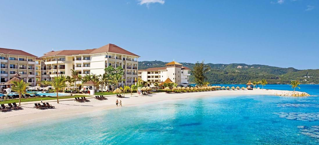 A view of Secrets Wild Orchid Montego Bay and the sugar white beach.